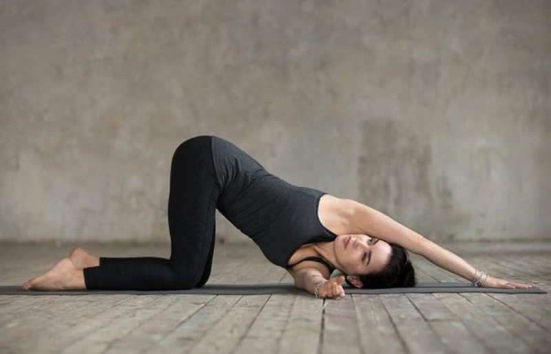 We Asked A Yoga Instructor For The Best Poses To Tackle Upper And Lower Back Pain